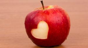 Heart on the fresh apple, a Valentine theme