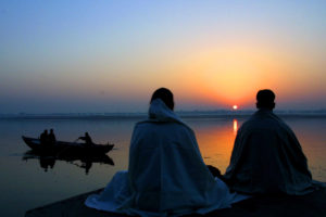 Hindu devotees meditate at dawn on the Ghats, or bathing areas, on the banks of River Ganges in Varanasi, India, Thursday, Dec. 6, 2001. The ashes of Beatles' George Harrison are reportedly to be immersed in the Ganges river by his relatives. Harrison died of cancer in Los Angeles on Nov. 29. (AP Photo/Amit Bhargava)